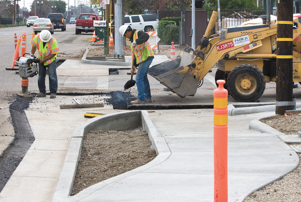 Eddie Moreno, left and Todd Juel work on curbs and gutters Wednesday along Riverside Avenue at 17th Street in Paso Robles.